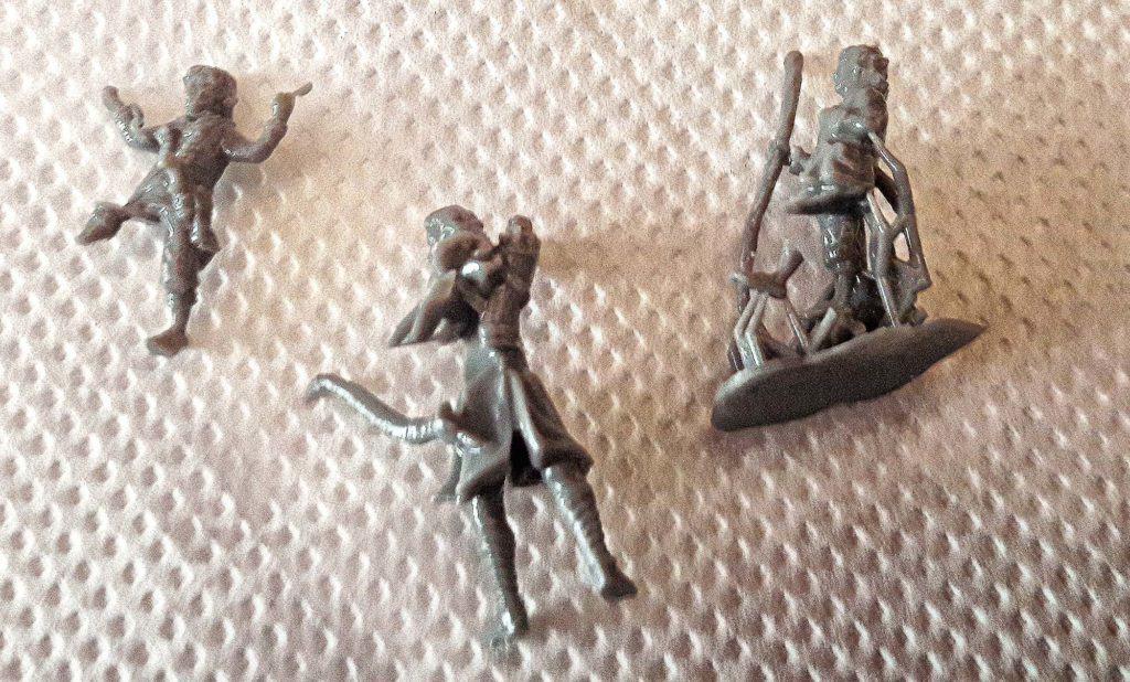 Three damaged 3d models of halflings lying on papertowel