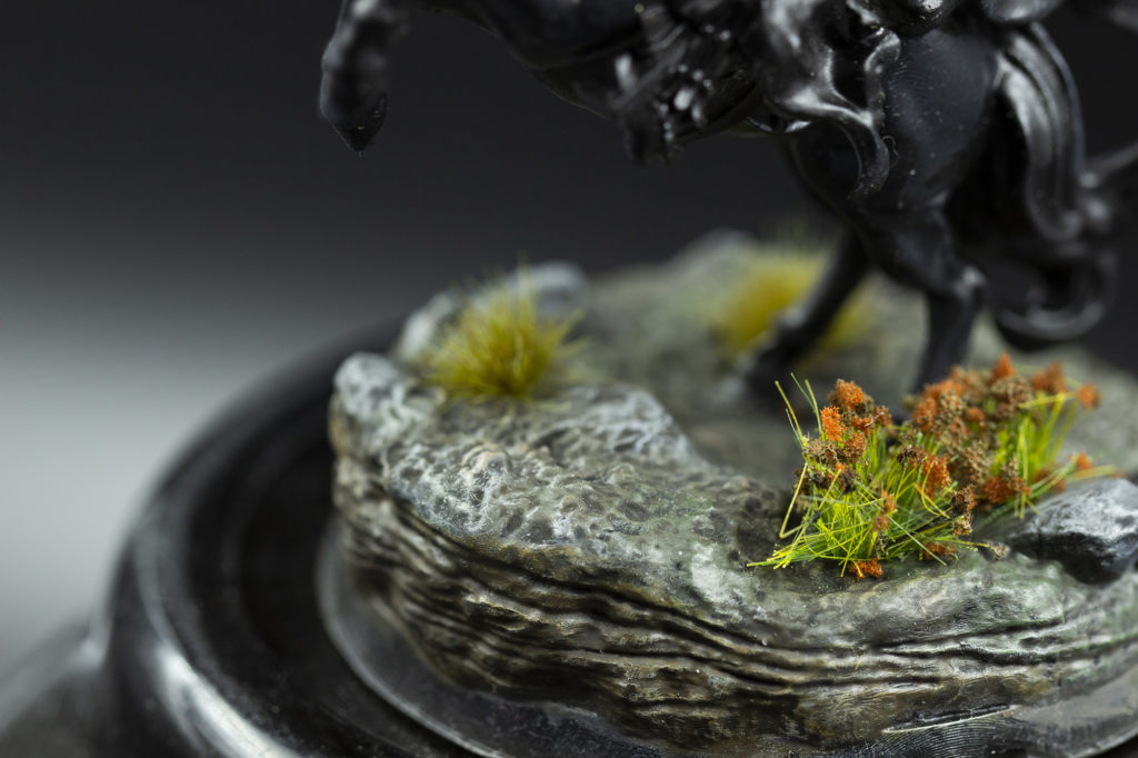 Close-up of the base with the bottom part of the black horse on it. Figurine and base have been printed out of the stl file.
