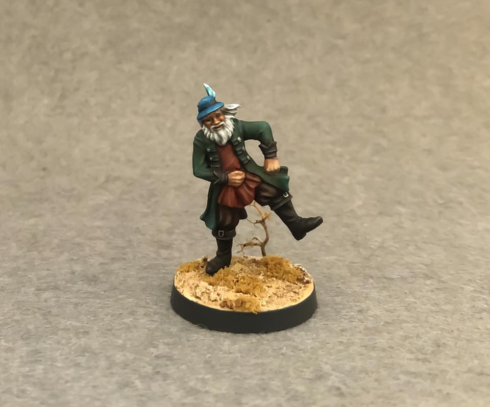 A painted 3d bard, straight from fantasy book, with a hat on his head, dancing on the golden leaves. Base made by Patron.
